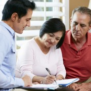 Financial Advisor Talking To Senior Couple